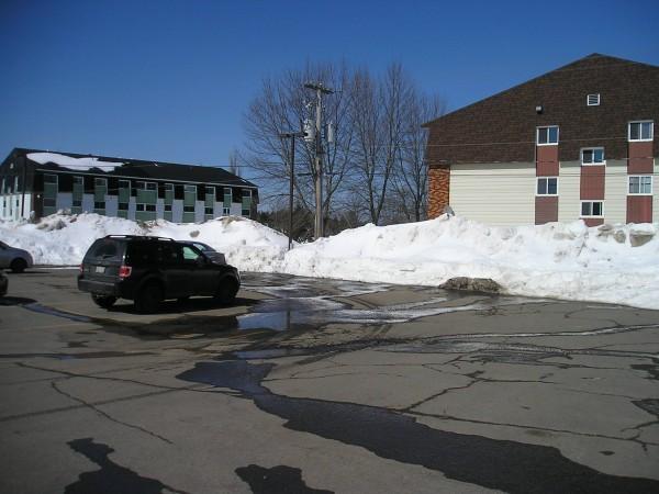 Across the Parking Lot.