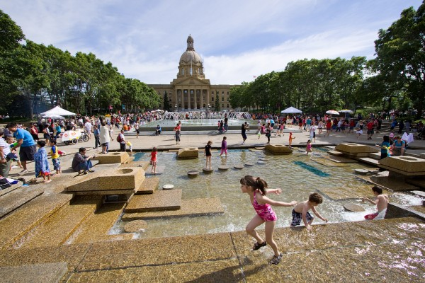 Families gather on a hot summer day at the Alberta Legislature Grounds, Edmonton. © Tom Young 2010