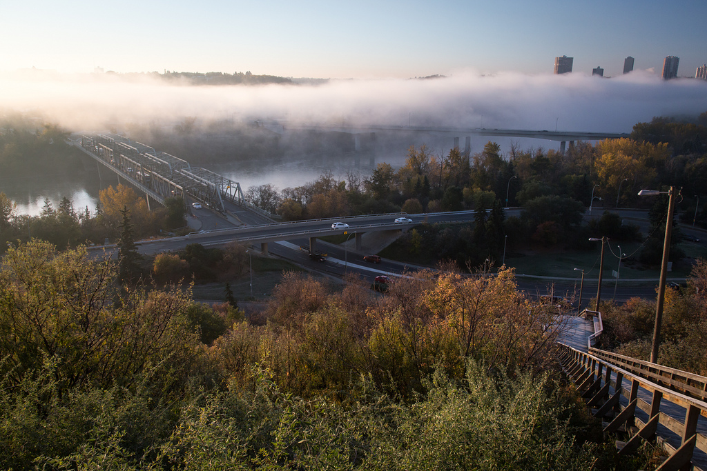 Morning fog creeps across the North Saskatchewan River in Edmonton's dramatic river valley. © Tom Young 2012