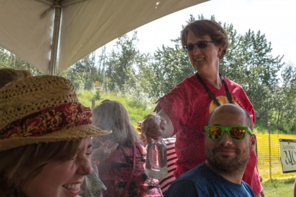 Beer garden misting volunteers keep festival-goers cool.