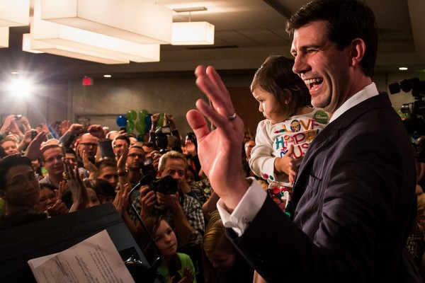 With daughter Alice in his arms, Don waves to supporters before giving his victory speech.