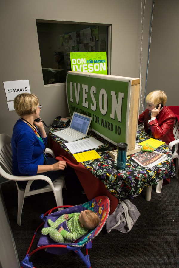 A sign from an earlier campaign partitions the space as volunteers of all ages work the phones at Iveson HQ.