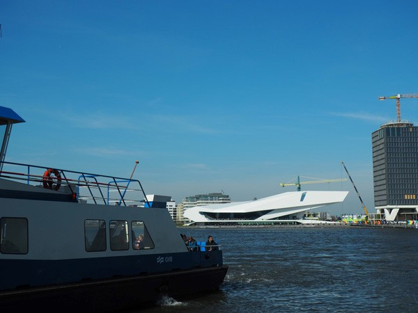 Amsterdam's Noord Eye film museum is an example of using a public amenity to kick start neighbourhood development, it is connected with a free ferry service.