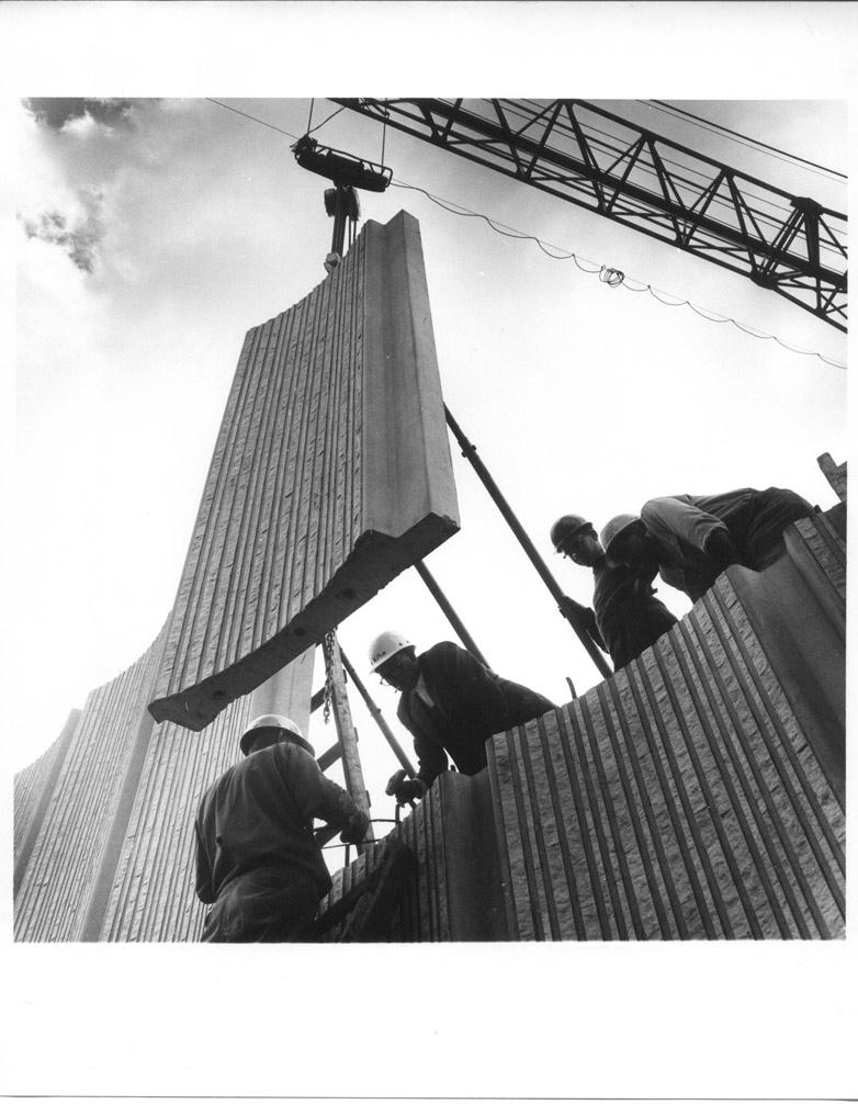 Construction: setting an exterior concrete panel into place.