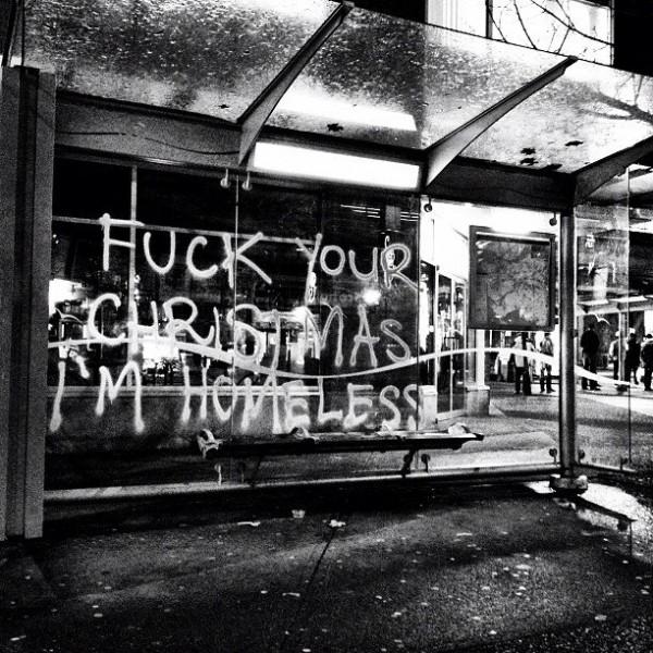 """F*** Your Christmas I'm Homeless!"" Graffitti on the corner of Commercial and Broadway. [Photo: Andrew Ferguson http://www.goldengod.net ]"