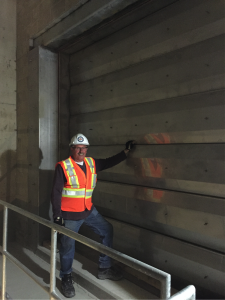 Ron Sturge, Senior Construction Inspector, Vaughan Metropolitan Centre Station stands with park of the fire ventilation system. Ron has working on every TTC subway project for 44 years.