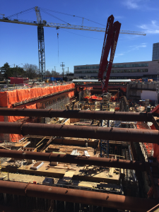 Large steel props hold the excavation open at York University Station