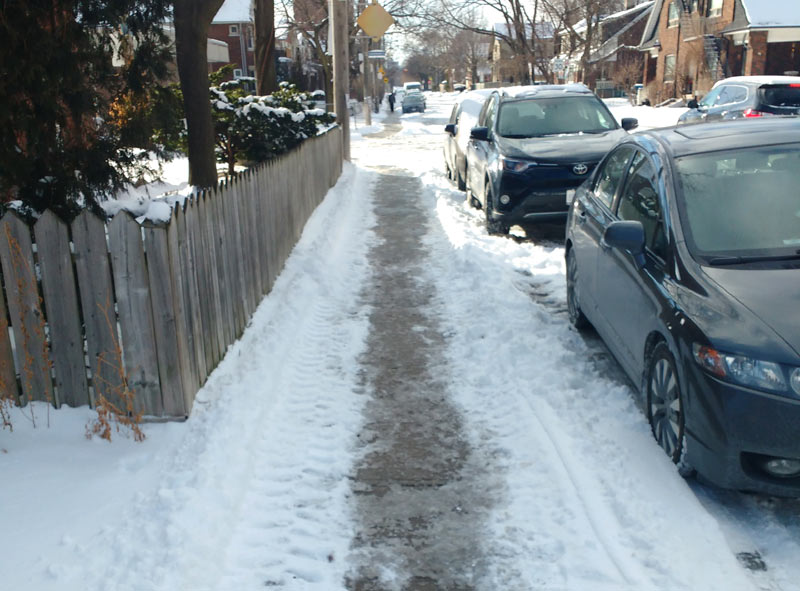 Plowed narrow sidewalk
