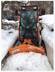 New sidewalk snow plow in action