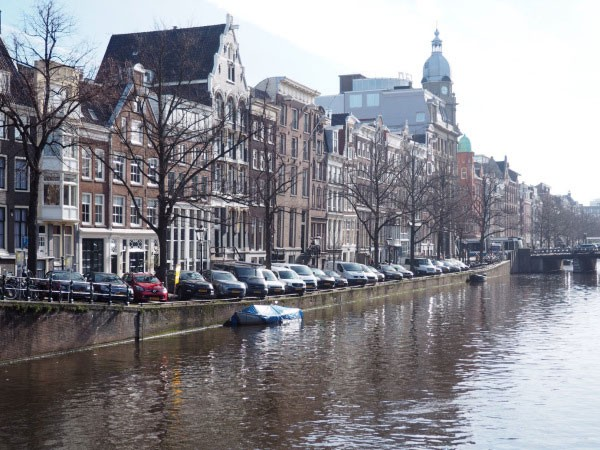 Cars parked along Amsterdam's famous canals.