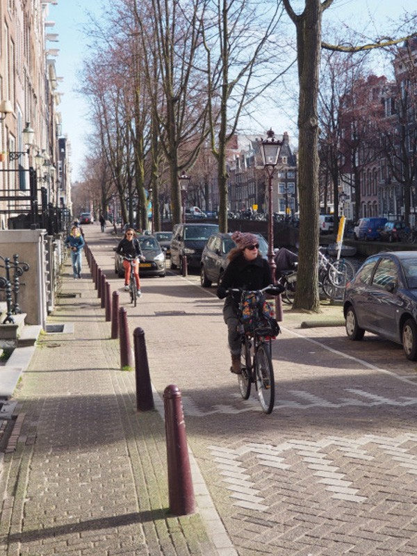 A shared street slows down traffic, but mixes cycling and driving.