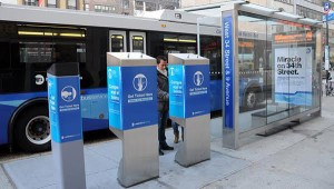 New York's 34th Avenue Bus Rapid Transit System sidewalk fare machines. Click to enlarge.