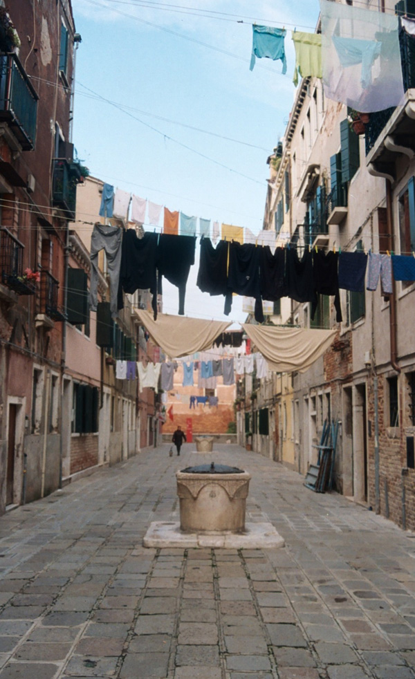 Laundry hanging over a rainwater cistern in Venice.